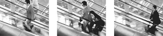 two briefcase carrying, business-suited adversaries in a knock down drag out fight on the escalator to nowhere.