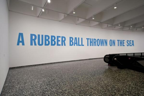 Lawrence Weiner. A RUBBER BALL THROWN ON THE SEA, Cat. No. 146, 1969 Text on wall variable. Joseph H. Hirshhorn Purchase Fund, 2007. The Panza Collection.