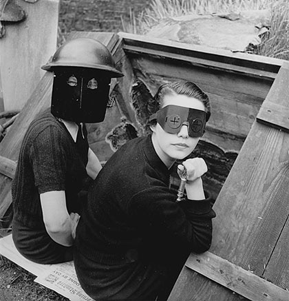 Lee Miller photographed women in fire masks in wartime London in 1944. [Source: Telegraph/Lee Miller Archives]