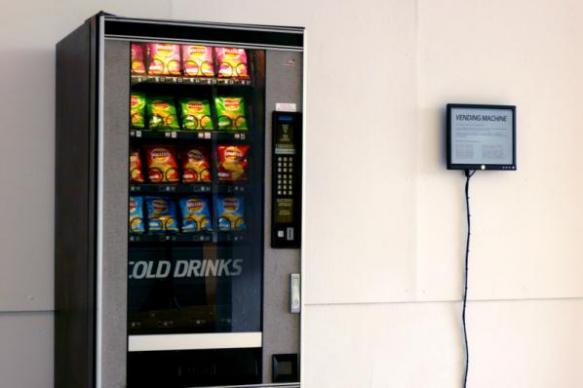 Ellie Harrison. Vending Machine. An installation for which an old vending machine is reprogrammed to release snacks only when news relating to the recession makes the headlines on the BBC News RSS feed.