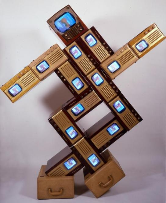 """Nam June Paik, """"Merce/Digital,"""" 1988 single-channel video sculpture with vintage television cabinets and fifteen monitors; color, silent, collection of Roselyne Chroman Swig, Copyright Nam June Paik Estate. (Image courtesy Nam June Paik Estate)"""