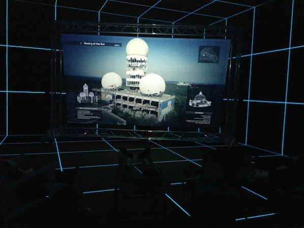 Hito Steyerl's Factory of the Sun. On the screen the old NSA listening post in former West-Berlin. The video is presented in a faux holodeck.