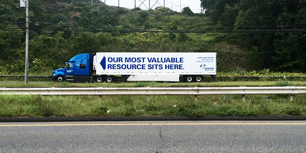 Truck with sign saying 'our most precious asset is here'