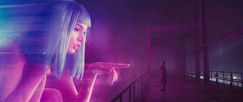 A larger-than-life commercial featuring a black-eyed avatar of Joi's character, Blade Runner 2049
