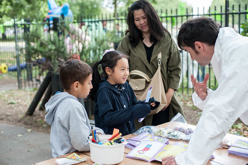Image of a family playing Planet Cashless 2029 at the Furtherfield Future Fair on 10th August 2019, image credit: Julia Szalewicz