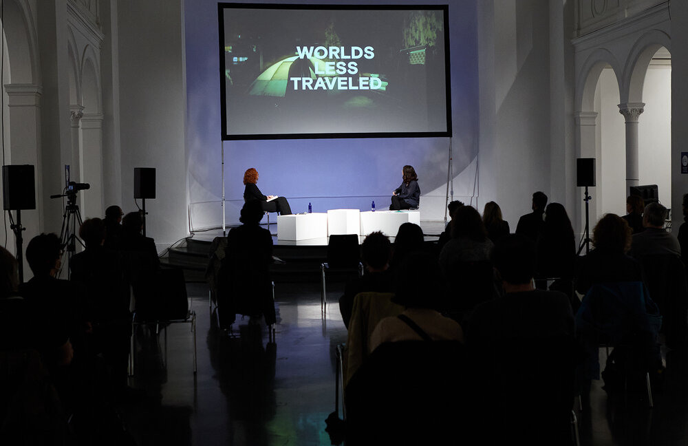 """Anna Ramskogler-Witt and Lucia Conti during the Keynote """"Worlds Less Travelled: Mega-Cities, AI & Critical Sci-Fi"""""""