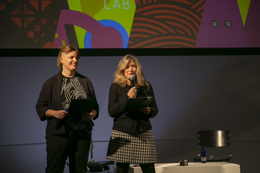 """Lieke Ploeger, community director of the Disruption Network Lab, and Dr. Tatiana Bazzichelli, founder and director of the Distruption Network Lab opening the 21st conference """"Borders of Fear"""""""