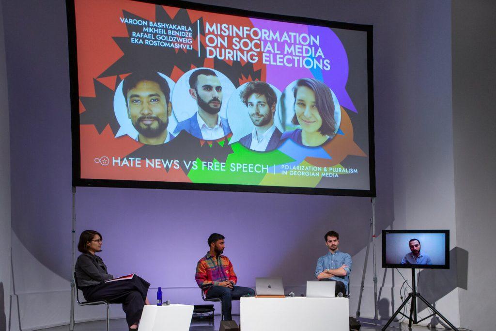 "Eka Rostomashvili, Varoon Bashyakarla, Rafael Goldzweig and Mikheil Benidze (screen) during the panel ""Misinformation on Social Media during Elections"""
