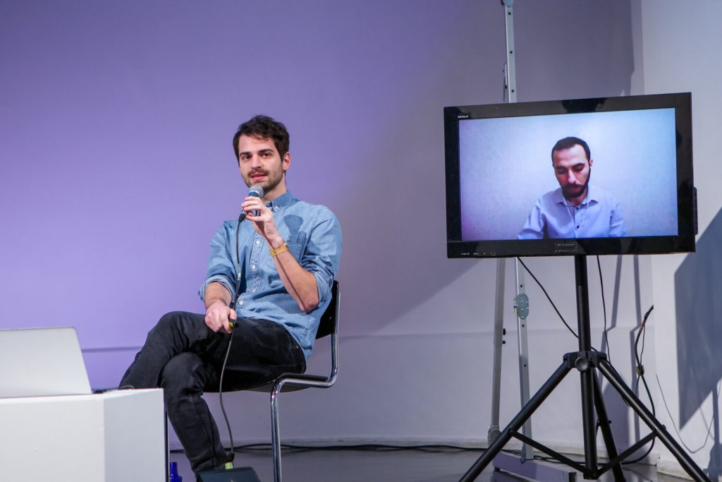 """Rafael Goldzweig and Mikheil Benidze (screen) during the panel """"Misinformation on Social Media during Elections"""""""